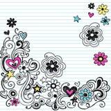 Le cahier de repère gribouille des remous et des fleurs Photos stock