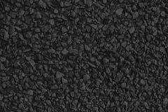 Le caillou monochrome a donné au contexte et au fond une consistance rugueuse extérieurs et en pierre de rocher images libres de droits