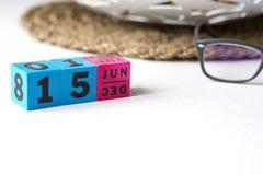 Le calendrier perpétuel a placé à la date du 15 juin Images stock