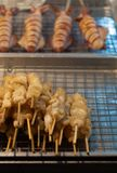 Le calmar, seiche, Grilled a découpé en tranches en vente de nourriture thaïlandaise de rue photographie stock libre de droits