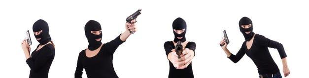 Le cambrioleur avec le pistolet d'isolement sur le blanc image stock