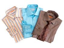 Le camice degli uomini a strisce piegati Fotografia Stock