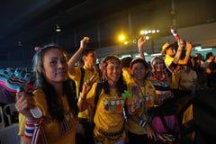 Le camice gialle. Immagini Stock