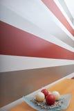 Le candele rosse & bianche con la caratteristica murano il fondo Immagini Stock