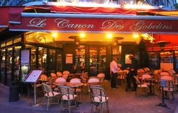 Le Canon des Gobelins is traditional French cafe located on Boulevard de Port Royal in Paris. Paris , France-May 19, 2019 : Le Canon des Gobelins is traditional stock photography
