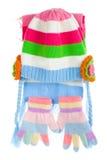 Le capuchon, l'écharpe et les gants de l'enfant Image stock