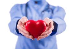 Le cardiologue de docteur d'isolement sur le fond blanc Photo stock