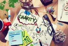 Le carnet avec des concepts de charité et beaucoup bourrent Photographie stock libre de droits