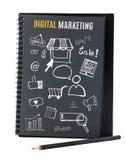 Le carnet sur le bureau avec l'icône se rapportent avec le marketing de Digital, Busine Images libres de droits