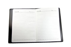 Le carnet sur le fond blanc et préparent pour l'inscription. Photographie stock libre de droits