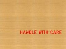 Le carton/manipulent avec soin Photographie stock libre de droits