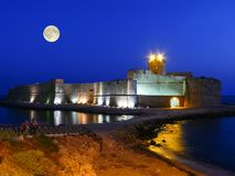 Le Castella in Calabria with the moon on the sky Royalty Free Stock Photo