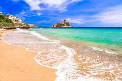 Le Castella .Isola di Capo Rizzuto - beaches and castles of Calabria, Italy. Impressive le Castella,near Crotone,view withgolden beach,azure sea and old castle stock images