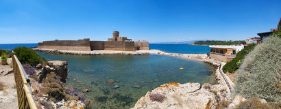 Le Castella, Isola di Capo Rizzuto, Crotone, Calabria, Southern Italy, Italy, Europe. Calabria, Italy, 04/07/2017: the Ionian Sea and the Aragonese castle of Le Royalty Free Stock Photography