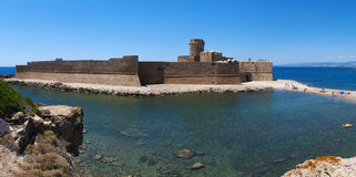 Le Castella, Isola di Capo Rizzuto, Crotone, Calabria, Southern Italy, Italy, Europe. Calabria, Italy, 04/07/2017: the Ionian Sea and the Aragonese castle of Le Royalty Free Stock Image