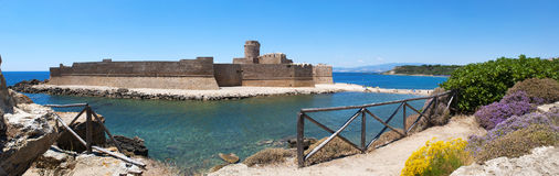 Le Castella, Isola di Capo Rizzuto, Crotone, Calabria, Southern Italy, Italy, Europe. Calabria, Italy, 04/07/2017: the Ionian Sea and the Aragonese castle of Le Royalty Free Stock Photos