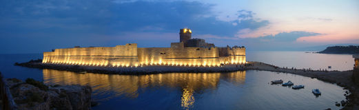 Le Castella by night. Le Castella is a beautifull castle completely in the Jonio sea. Here is a panoramic picture by night Stock Photography