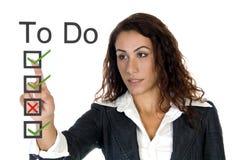 le CEO de corporation font la liste femelle à Photographie stock