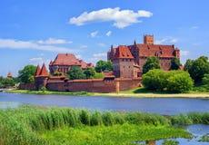 Le château de l'ordre Teutonic prussien de chevaliers dans Malbork, PO Image libre de droits