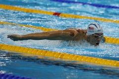 Le champion olympique Michael Phelps des Etats-Unis nage la chaleur 3 de papillon du ` s 200m d'hommes de Rio 2016 Jeux Olympique photographie stock libre de droits