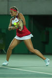 Le champion olympique Monica Puig du Porto Rico dans l'action pendant les femmes de tennis choisit la finale de Rio 2016 Jeux Oly Image stock
