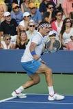 Le champion Pat Cash de Grand Chelem pendant l'US Open 2014 soutient le match d'exposition Photographie stock libre de droits