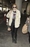 Le chanteur Kesha est vu chez LAX images stock