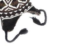 Le chapeau de laine, gris a tricoté le chapeau de laine avec l'empêchement Image stock