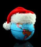 Le chapeau de Santa de globe. Photos libres de droits