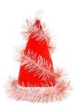 Le chapeau rouge de Santa avec la tresse rose d'isolement Photographie stock