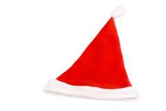 Le chapeau rouge de Santa d'isolement sur le blanc Photographie stock libre de droits