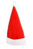 Le chapeau rouge de Santa d'isolement sur le blanc Photos libres de droits