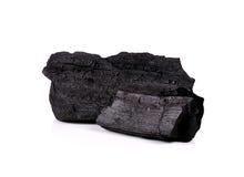 Le charbon de bois d'isolement sur le fond blanc Photos stock