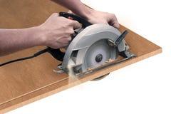 Le charpentier avec a vu Images stock