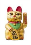 Le chat chanceux - Maneki Neko retenant une pièce de monnaie de Koban Photographie stock libre de droits