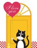 Le chat retient un ballon de coeur Image libre de droits