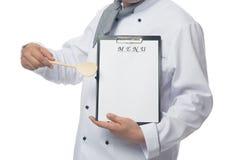 Le chef montre l'endroit pour votre menu Images libres de droits