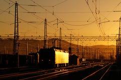 Le chemin de fer dans le coucher du soleil Photographie stock libre de droits