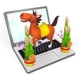 Le cheval de nouvelle année sur Lap Top Photos libres de droits