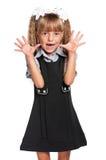 le cheveu de fille a isolé le blanc uniforme futile de petit de pupille studio d'école Images libres de droits