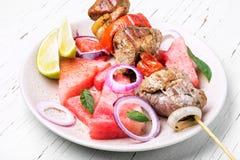 Le chiche-kebab avec la pastèque garnissent Photos libres de droits
