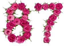 Le chiffre arabe 87, quatre-vingt-sept, des fleurs rouges de a monté, isola Images libres de droits