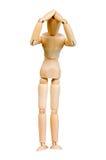 Le chiffre humain en bois de statuette d'homme fait à des expériences de montux l'action émotive sur un fond blanc Images stock