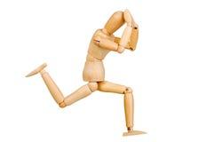 Le chiffre humain en bois de statuette d'homme fait à des expériences de montux l'action émotive sur un fond blanc Photographie stock libre de droits