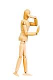 Le chiffre humain en bois de statuette d'homme fait à des expériences de montux l'action émotive sur un fond blanc Photo stock