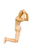 Le chiffre humain en bois de statuette d'homme fait à des expériences de montux l'action émotive sur un fond blanc Images libres de droits