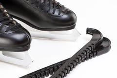 Le chiffre patins des hommes professionnels avec des couvertures de lame ensemble over Photo libre de droits