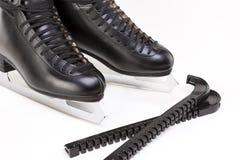 Le chiffre patins des hommes professionnels avec des couvertures de lame ensemble over Photographie stock libre de droits