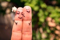 Le chiffre sur les doigts amoureux Photos libres de droits