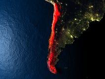 Le Chili en rouge de l'espace la nuit Images stock